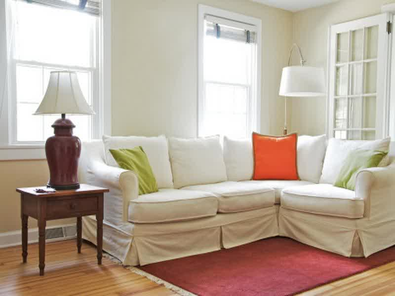 small sectional living room furniture sets finance apartment size selections for your space l shaped with white slipcover and fun colored accent pillows red rug vintage styled side