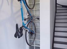 contemporary entry way idea with stairs and wall mounted bike rack