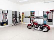 contemporary garage metal cabinets metal hooks metal bins white walls white ceramic tiles floors