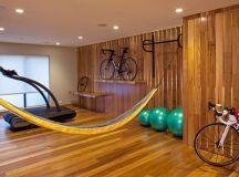 contemporary gym home wood board walls with hidden lights wood board floors bike rack