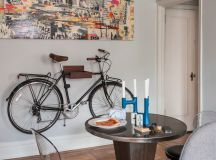 eclectic dining room idea wall bike rack idea round top dining table black leather dining chairs with clear acrylic back rests