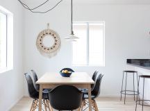 mid century modern dining room idea black mid century modern chair with wood legs oak top dining table pale toned wood floors long & irregular wired pendant lamps all white walls with glass windows