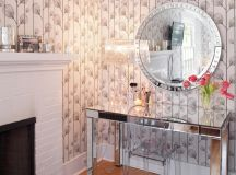 mirrored makeup vanity table solid and transparent acrylic vanity chair round shaped mirror with metallic frames grey wallpapers medium toned wood floors