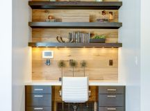 modern home office idea arranged recessed lamps black doff open shelves for books wood wall background white top working table movable white working chair light toned wood floors
