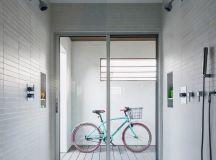modern minimalist entry way in all white standing bike storage idea