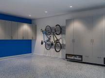 modern minimalist garage idea grey laminate cabinets and closet blue laminate walls wall mounted bike racks grey Epoxy coating floors