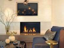 contemporary living room smokey glass chandelier brass side table metallic covered accent pillow dark leather chair black finishing tree trunk coffee table standard fireplace