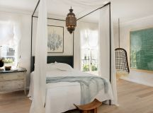 eclectic bedroom idea bed frame with canopy in black white bed drapery shabby and light bedside table dark toned hanging swing Tuscan style pendant light light toned wood floors