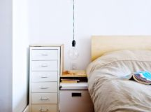industrial bedroom idea wood platform bed frame with headboard dark toned wood floors white drawer system with wood frames white bedside table very low wired bulb pendant lamp