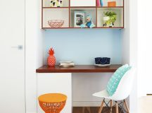 kids' study room idea light blue sea walls wall organizers with dark toned wood frames dark toned wood working desk mid century modern chair with wood legs