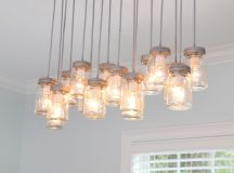mason jar pendant lamps supported by bronze chains on ceilings