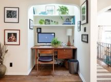 mediterranean home office idea with skylight white floating shelves hardwood working desk black leather chair with hardwood structure