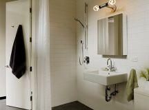 modern bathroom vanity idea floating vessel in white white ceramic tiles walls walk in shower with white shower curtains bulb vanity light fixture