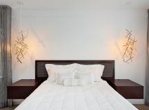scandinavian master bedroom idea dark finished bed frame with headboard and integrated bedside tables white bedding treatment super interesting pendant lamps