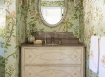 shabby chic powder room idea pale toned vanity undermount light green wallpaper with floral motifs oval shaped mirror