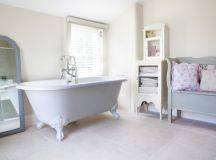 shabby chic vintage bathroom white claw foot bathtub vintage style cabinet in white light grey wood chair blue framed standing mirror