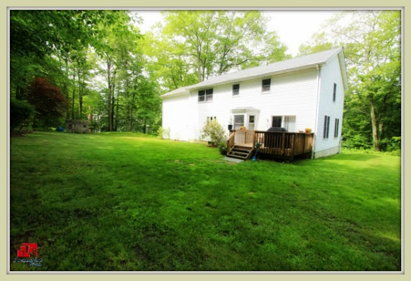 Relaxation comes naturally on the backyard deck of this beautiful Bethel CT home for sale.