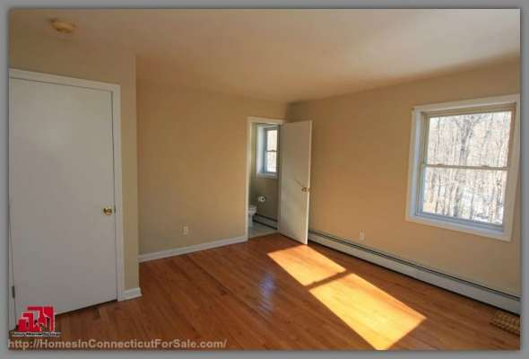 End your busy days going home to this home for sale in Kent CT that offers a master bedroom that has everything you need for relaxation.