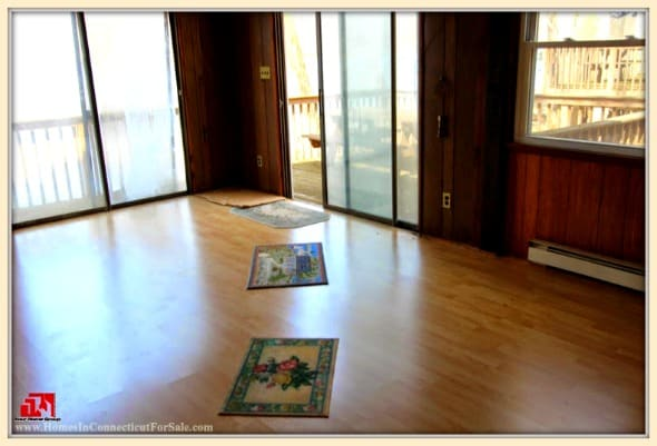 A spacious living room awaits you inside this lovely Danbury CT lakefront home for sale.