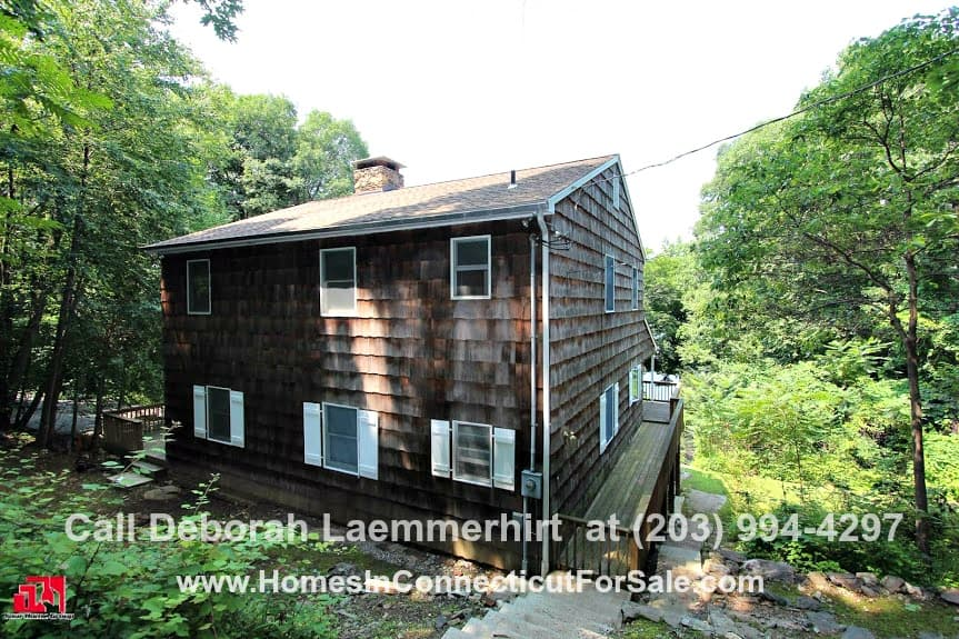 If peace and quiet is your priority when looking for a house then this home for sale in Candlewood Lake is perfect for you.