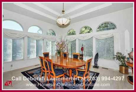 Dine in style in the formal dining room of this strikingly attractive 4 bedroom home for sale in New Milford CT.