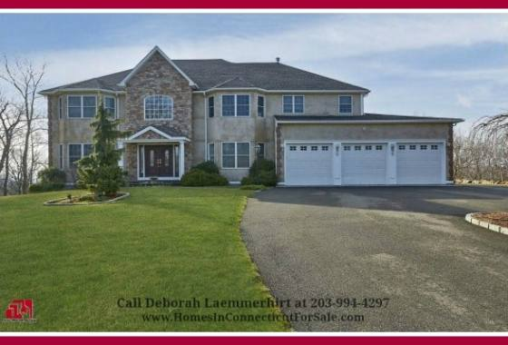 This gorgeous New Fairfield CT luxury home for sale in Red Fox Crossing exudes superiority throughout with its beautifully manicured landscape and spectacular exteriors and interiors.