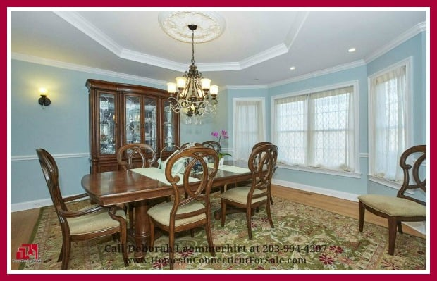 Dine like royalty in the formal dining room of this strikingly attractive Red Fox Crossing 6 bedroom luxury home for sale in New Fairfield CT.