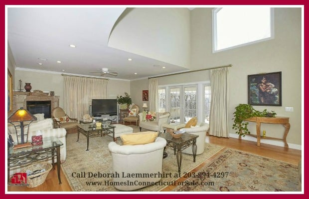 A perfectly cozy and spacious living room awaits you in this stunning Red Fox Crossing 6 bedroom luxury home for sale in New Fairfield CT.