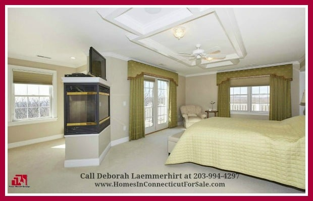 End your busy days in the wonderful retreat the expansive master bedroom offers in this exquisite luxury home for sale in New Fairfield CT.