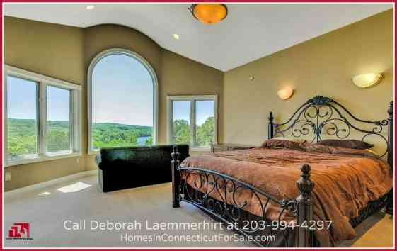 Say goodbye to sleepless nights when you set foot in the master suite of this Haddam CT waterfront home with a pool.