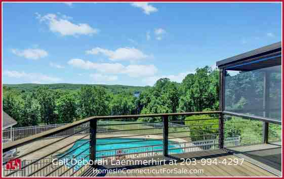 Enjoy this Haddam CT waterfront home with a pool that is set in a breathtaking backdrop of the lush greens and Connecticut River.