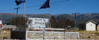 The welcome sign to mount pleasant utah.