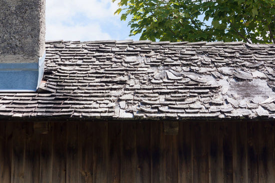 A roof that needs repair before winter.