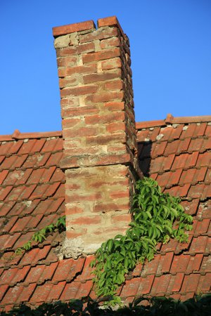 A chimney in need of spring maintenance.