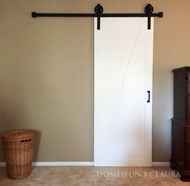 Master bedroom refresh | Homespun by Laura | The master bathroom: Our DIY barn door gives so much more space to our tiny bathroom!