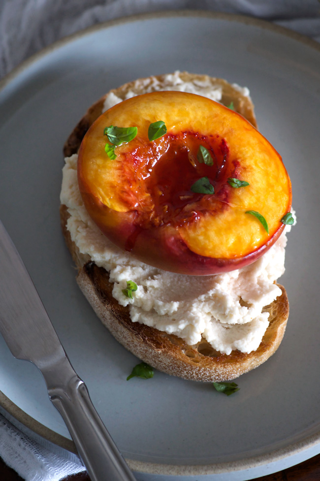 Roasted Peach Toasts with Vanilla Macadamia Ricotta | Sweet vanilla roasted peaches with creamy dairy-free ricotta - the perfect decadent weekend breakfast. Vegan, refined sugar free, gluten free option.