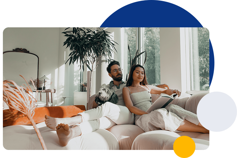 couple seating on couch inside home