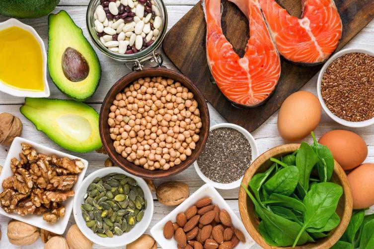 Foods high in omega-3 fatty acids, including nuts, seeds, salmon, avocado, eggs, spinach, walnuts, and many types of beans or legumes