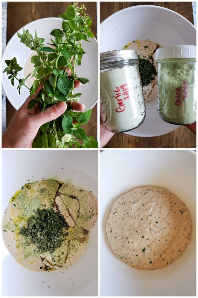 """A four-way image collage, showing the process of mixing the sourdough pizza crust dough. First, a hand holding several sprigs of fresh garden oregano, hovering over a white bowl of flour. Next, two glass jars of homemade seasoning power. One is more white in color, labelled """"garlic"""" and the other more green, labelled """"onion"""". The same bowl of dough ingredients is in the background. The third image shows the same white bowl, a close up of the ingredients inside but not yet mixed together: piles of flour, chopped green herbs, sourdough starter, and a drizzle of olive oil. The final image is a ball of mixed dough with green specs from the herbs, sitting in the bottom of the bowl"""