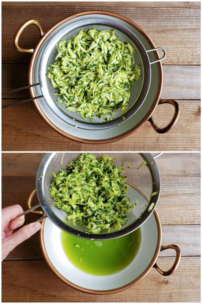 A two way image collage, the first image shows a stainless steel mesh strainer full of grated zucchini, sitting atop a white ceramic bowl with copper plated handles as well as the outer edge. The  second image shows a hand has lifted the strainer partially off of the bowl, revealing green watery remains in the bottom of the bowl. The zucchini has been properly salted and drained of most of its moisture, making it perfect for zucchini fritters.