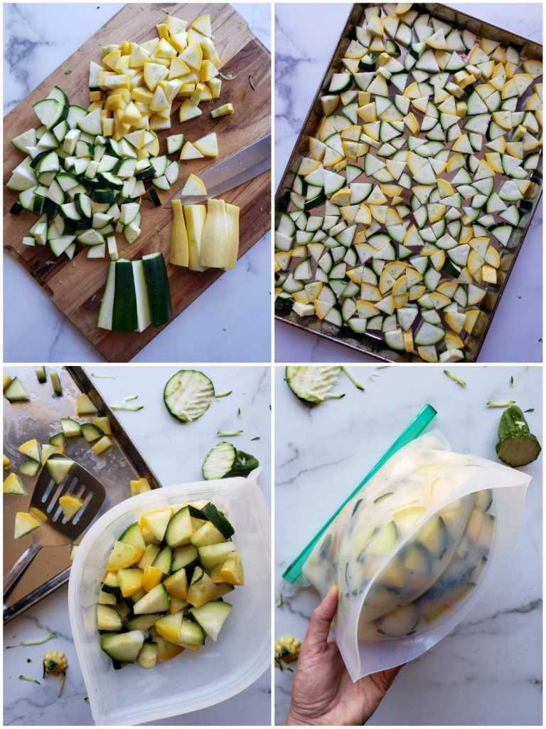 A four part image collage, the first image shows a wooden cutting board with green and yellow squash cut into bite size chunks. The remaining half of each squash is waiting to be chopped below the already prepared squash. The second image shows the cut squash on a parchment paper lined baking sheet. The third image shows the frozen squash packed into a resealable silicone bag. A spatula is sitting on the baking sheet with the remaining cut squash. The fourth image shows DeannaCat's hand holding the bag after it has been sealed, illustrating the amount of squash held within it. Freeze zucchini for use in soups and stews throughout the fall and winter months.