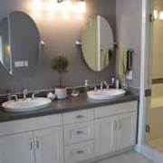 ensuite double white sinks bathroom counter and oval mirrors bathroom renovation red deer