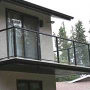 balcony exterior of grey and black house in red deer alberta custom home renovation