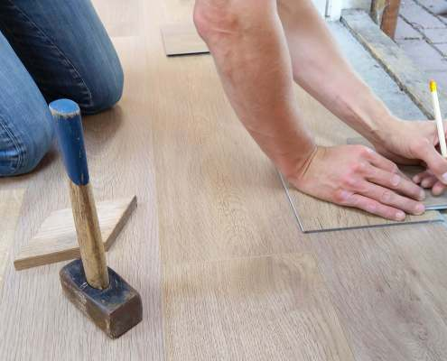 man measuring floors for home renovation project