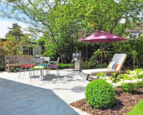 backyard patio with lawn furniture and umbrella