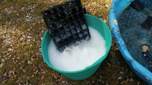 cleaning pots in soap and water