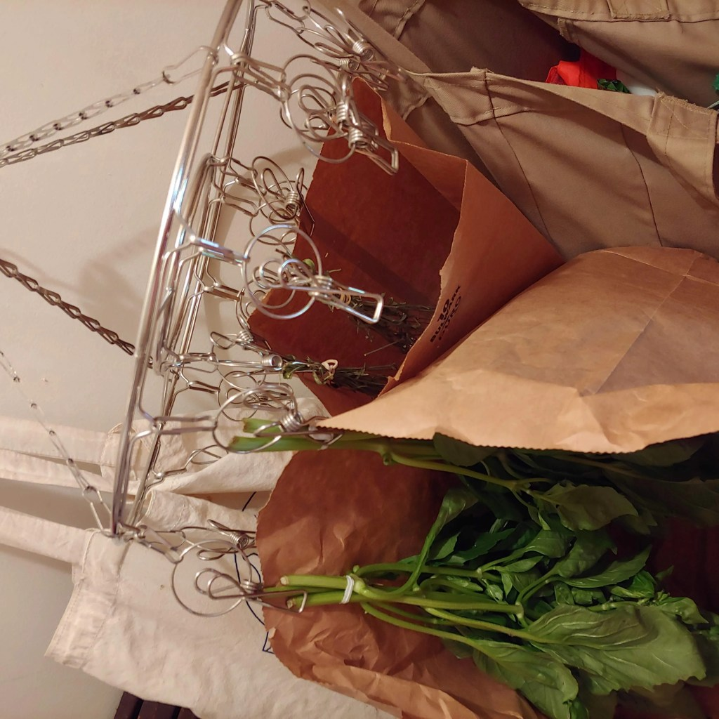 using an herb drying rack to dry herbs