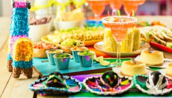 Fiesta party buffet table with traditional Mexican food | Easy DIY Cinco de Mayo Decorations For Your Fiesta At Home | cinco de mayo crafts | Featured