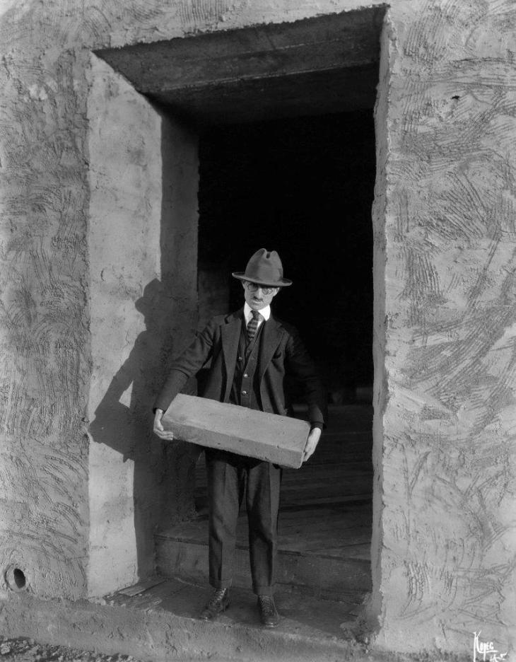 19702 A Man Possibly Albert Kopec Holding Adobe Brick La Casa Nueva 91.18.1.3
