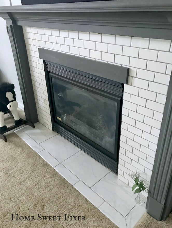 white subway tile fireplace makeover